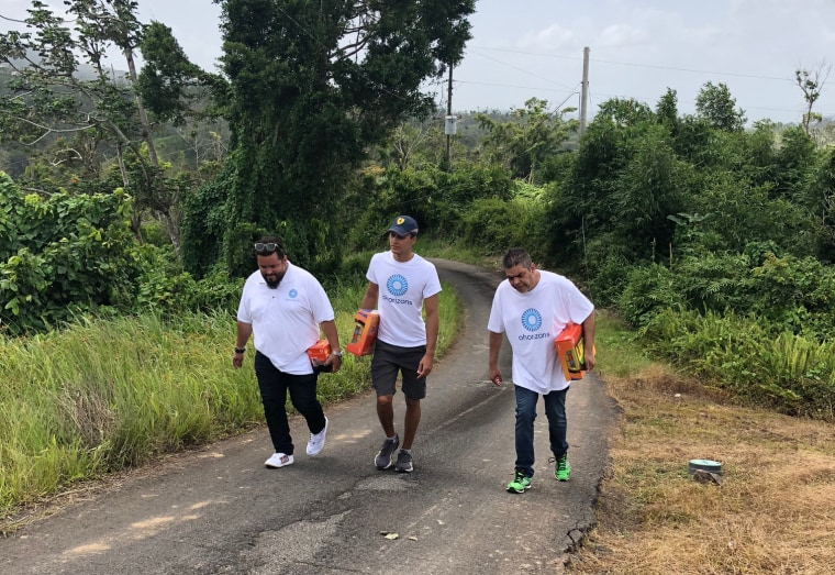 Image: OHorizons' team travels from house to house in Yabucoa, Puerto Rico to distribute solar equipment