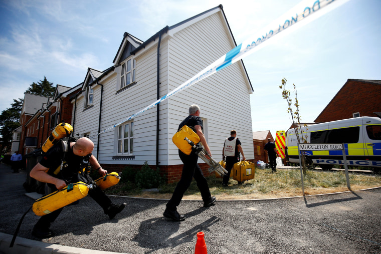 Image:  Fire and Rescue Service personnel arrive with safety equipment at the site of a housing estate on Muggleton Road, after it was confirmed that two people had been poisoned with the nerve-agent Novichok, in Amesbury