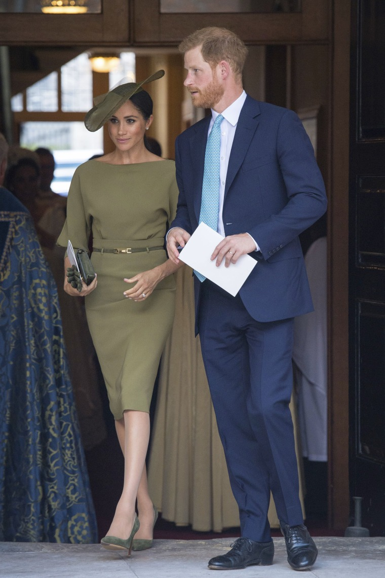 Britain's Prince Harry and Meghan Duchess of Sussex leave after the christening service of Prince Louis at the Chapel Royal, St James's Palace, London, Monday, July 9, 2018.
