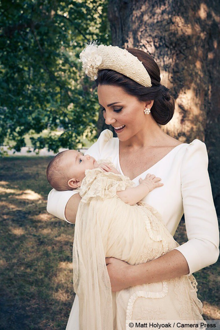 Duchess Kate holds Prince Louis in a beautiful close up.