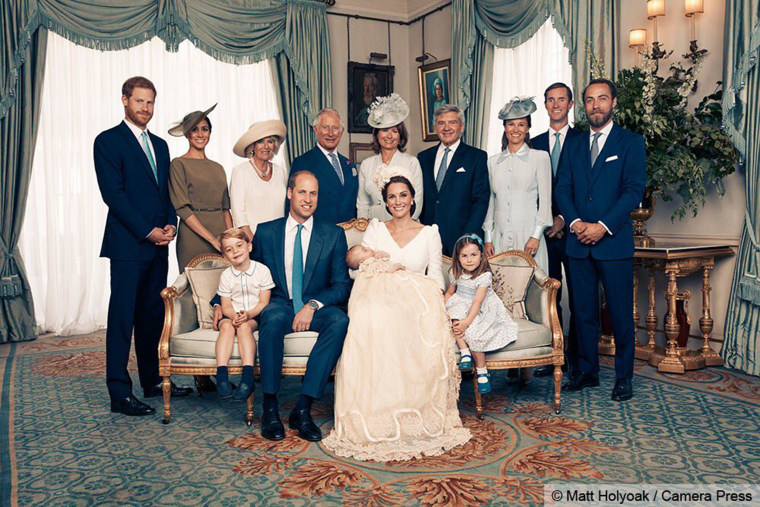 Sitting together (left to right) are Prince George, the Duke of Cambridge, baby Prince Louis, the Duchess of Cambridge and Princess Charlotte. Standing (left to right): The Duke of Sussex, the Duchess of Sussex, the Duchess of Cornwall, the Prince of Wales, Mrs. Carole Middleton, Mr. Michael Middleton, Mrs. Pippa Matthews, Mr. James Matthews and Mr. James Middleton.