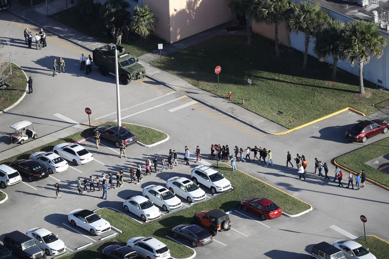 Image: People are brought out of the Marjory Stoneman Douglas High School