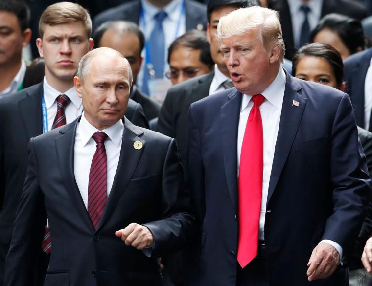Image: Trump and Putin speak at the APEC summit