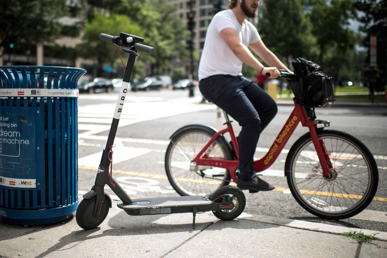 Image: A Bird electric scooter is parked on a street in downtown Washington