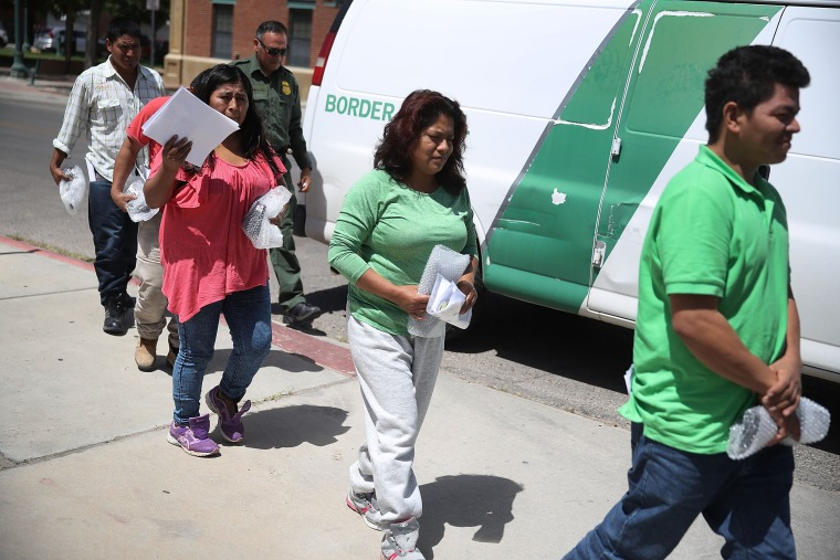 Image: Migrant parents separated from their children by U.S Customs and Border Patrol arrive at the Annunciation House migrant shelter