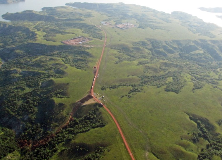 Image: Discolored vegetation, lower left, leading from a pipeline where an estimated 1 million gallons of saltwater spilled from an underground pipeline