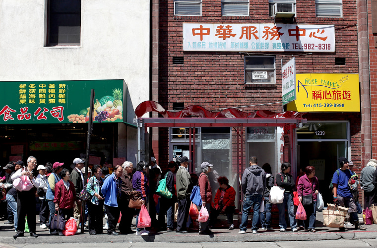 Image: People wait for a bus in Chinatown on June 19, 2012 in San Francisco.