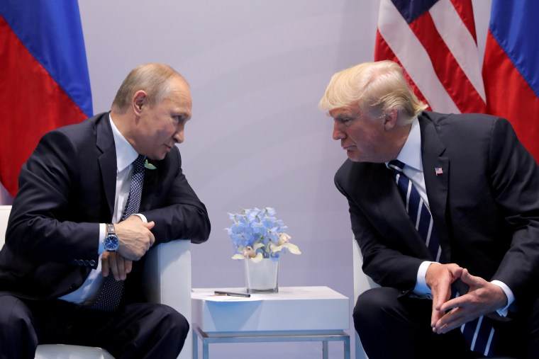 Image: Russia's President Putin talks to U.S. President Trump during their bilateral meeting at the G20 summit in Hamburg
