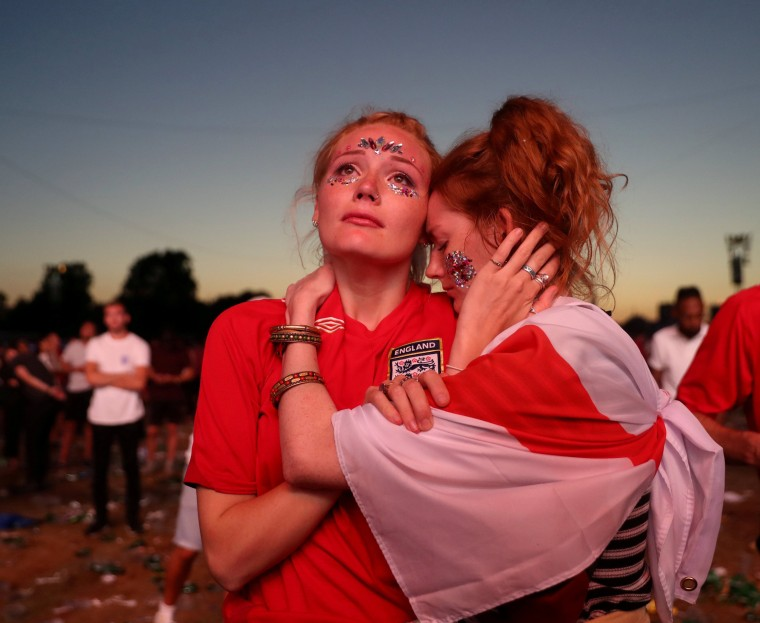 Image: England fans console each other following the World Cup semifinal match against Croatia