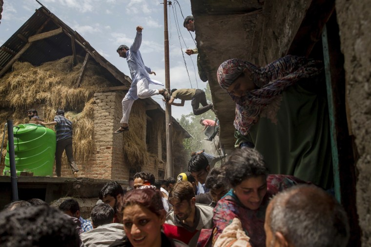 Image: Villagers flee after hearing rumors of Indian army soldiers returning back to the site