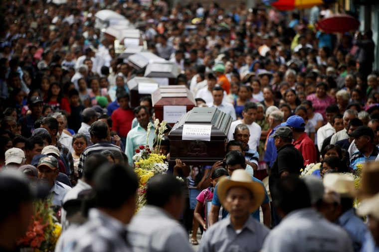 Image: Relatives hold a funeral for 10 family members killed in last month's deadly eruption of the Volcano of Fire