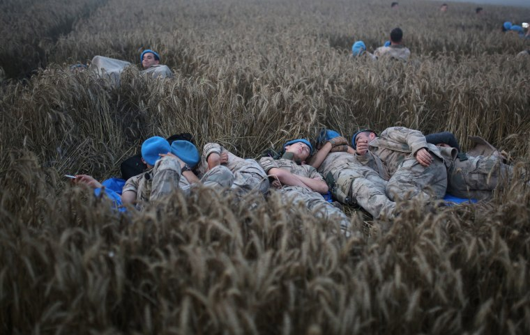 Image: Turkish soldiers rest at the site of a train accident in Tekirdag, Turkey