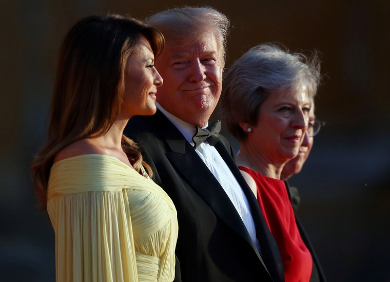 Image: British Prime Minster Theresa May and her husband Philip stand together with U.S. President Donald Trump and First Lady Melania Trump at the entrance to Blenheim Palace near Oxford