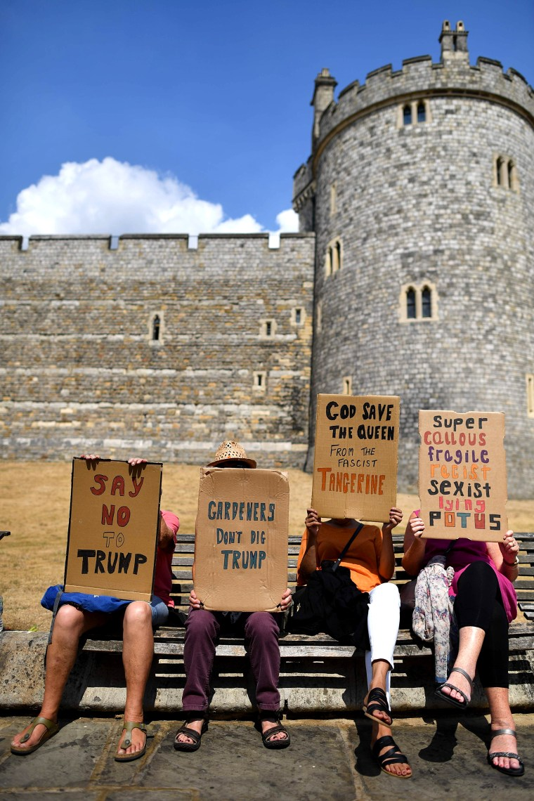 Image: Protesters against the visit of US President Donald Trump carry placards outside Windsor Castle