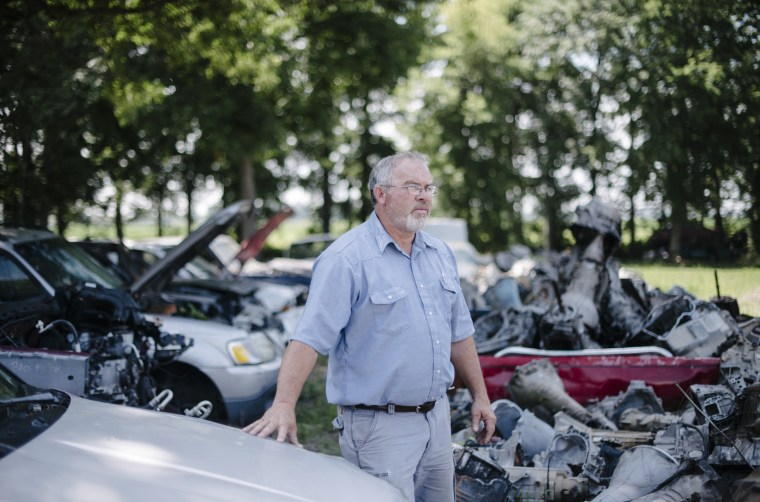 Image: Billy Redwine in the car yard of his family's auto parts business