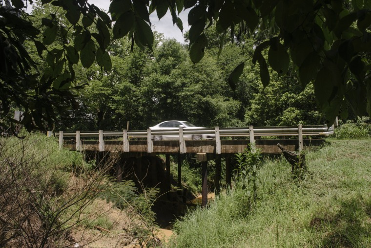 Image: A car passes over a newly reopened bridge in Hinds County