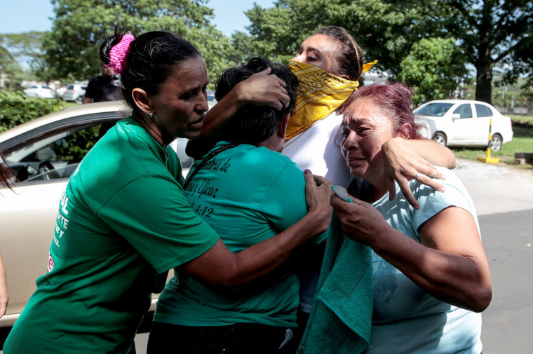 Image: Relatives embrace an university student who was freed after being trapped overnight in Divine Mercy Catholic Church where they took shelter as pro-government gunmen shot at them, in Managua