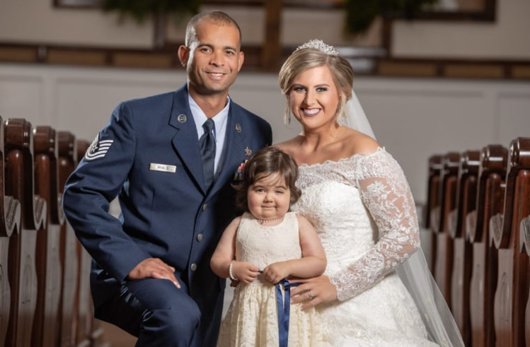 Ryals with her husband, Adrian, and her special flower girl, Skye.