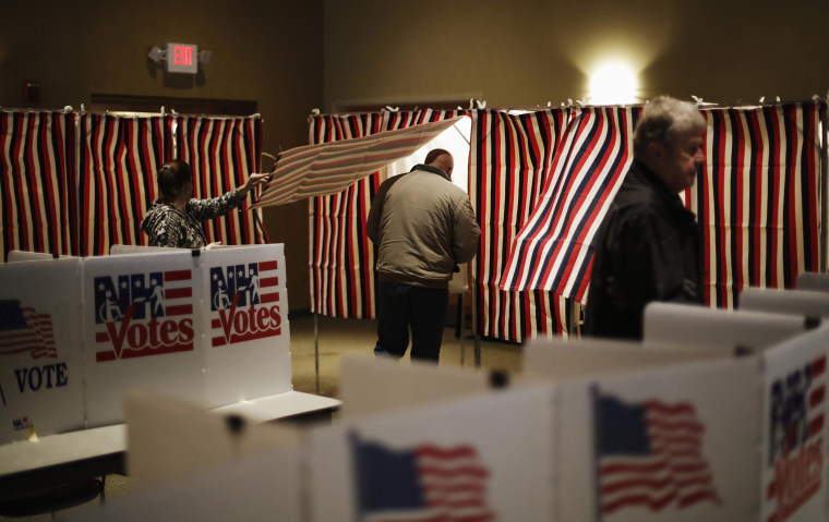 Image: A voter steps into a voting booth to mark his ballot at a polling site for the New Hampshire primary on Feb. 9, 2016, in Nashua, New Hampshire.