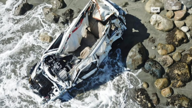 Angela Hernandez's car rests at the bottom of a cliff in Big Sur, California.