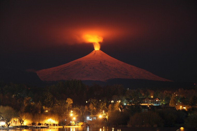 Image: The Villarrica Volcano is seen at night from Pucon town, Chile on July 12, 2015