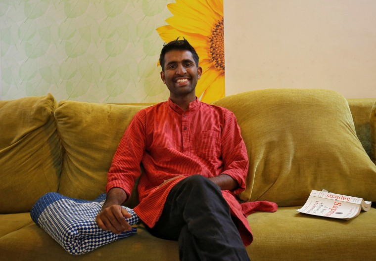 Image: Akhilesh Godi, one of the petitioners challenging India's ban on homosexuality, poses for picture inside his house in Bengaluru