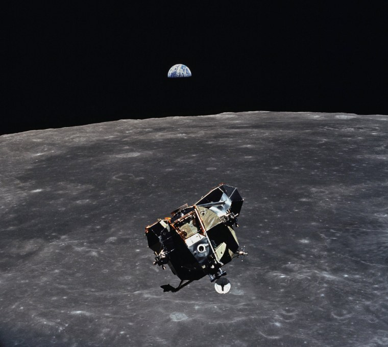 Image: Image: The Apollo 11 Lunar Module ascent stage, with astronauts Neil A. Armstrong and Edwin E. Aldrin Jr. aboard, is photographed from the Command and Service Modules (CSM) during rendezvous in lunar orbit