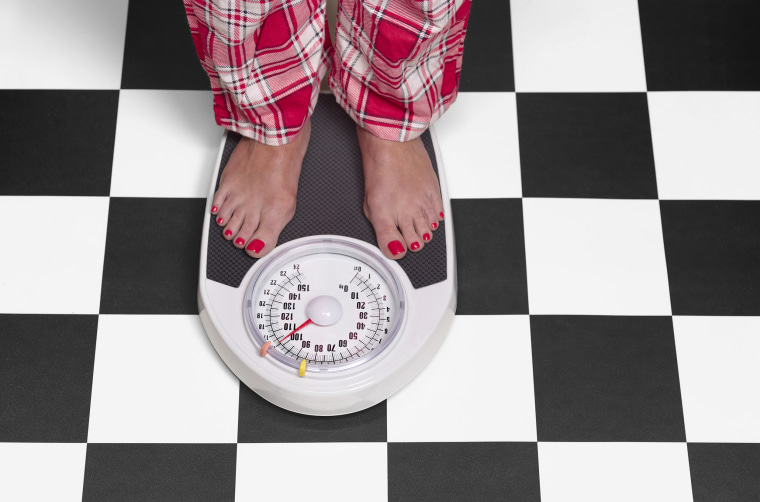 Image: Woman on bathroom scales