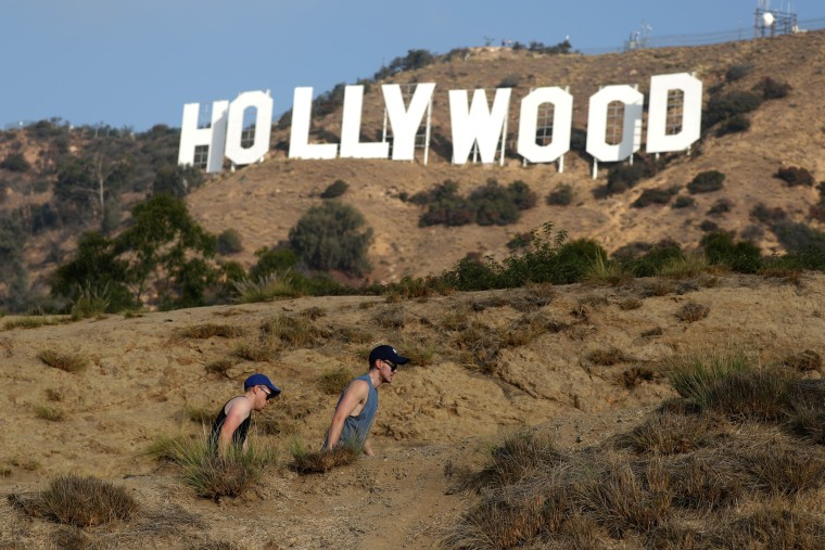 Image: FILE PHOTO:    Hikers pass by the Hollywood sign in Hollywood