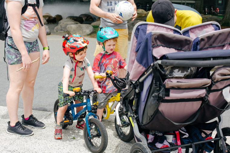Image: Zyler,3, and Kadyn,3, run into friends while riding their bikes home