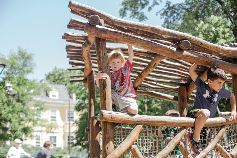 Image: Kadyn, 3, plays in the park in Cambridge