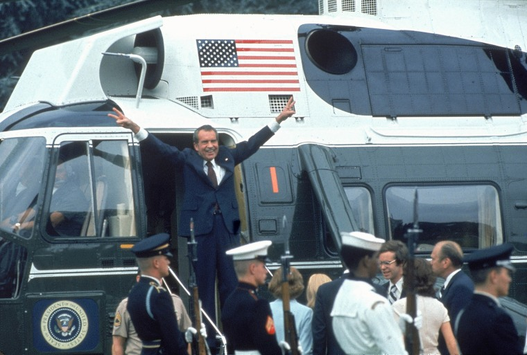 Image: Pres. Richard Nixon w. arms outstretched w. veed f