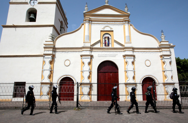Image: Members of Nicaragua's Special Forces walk past a church during clashes with anti-government protesters in the indigenous community of Monimbo in Masaya