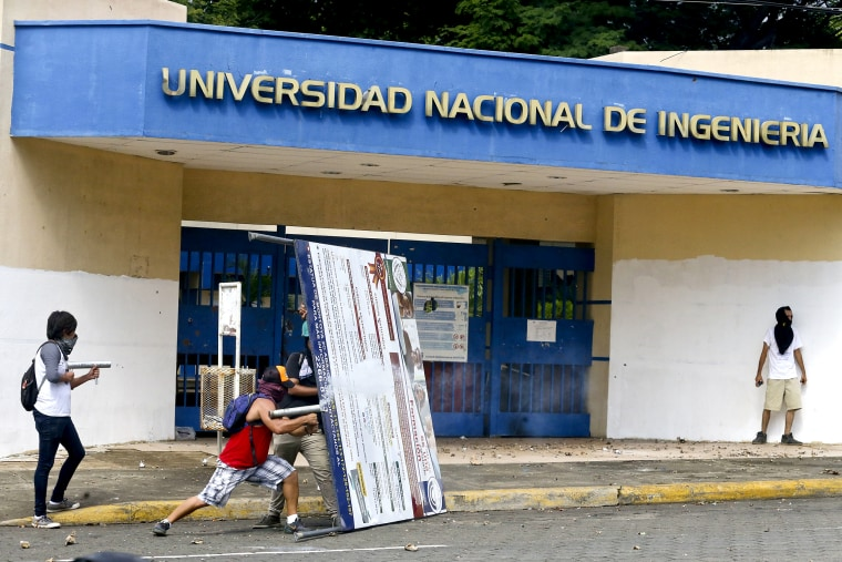 A demonstrator fires a home-made mortar at the police from outside the National Engineering University, during a protest against Nicaragua's President