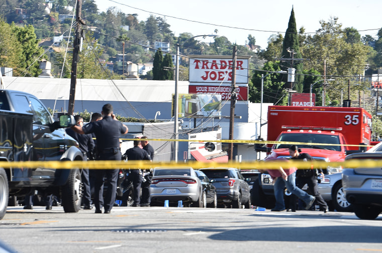 Image: Police officers guard a supermarket with a barricaded suspect in the Silver Lake area of Los Angeles