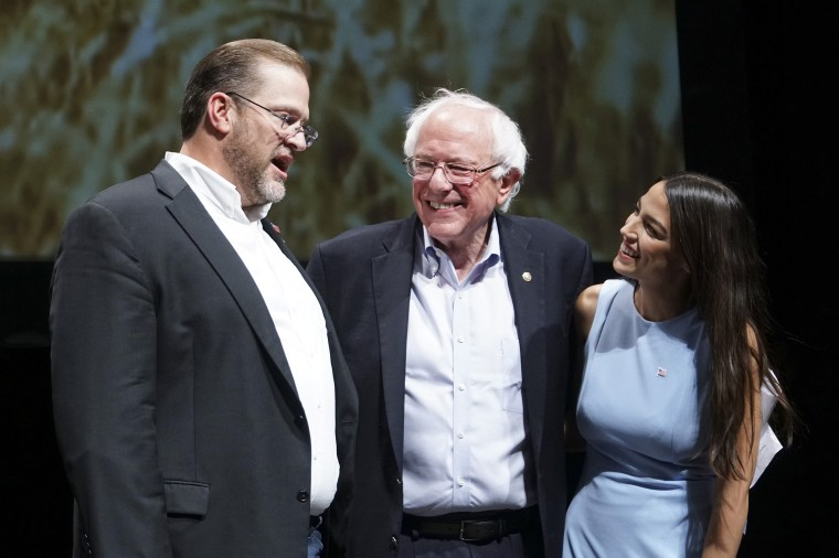 Image: Kansas congressional candidate James Thompson, left, U.S Sen. Bernie Sanders, I-Vt.,  and Alexandria Ocasio-Cortez