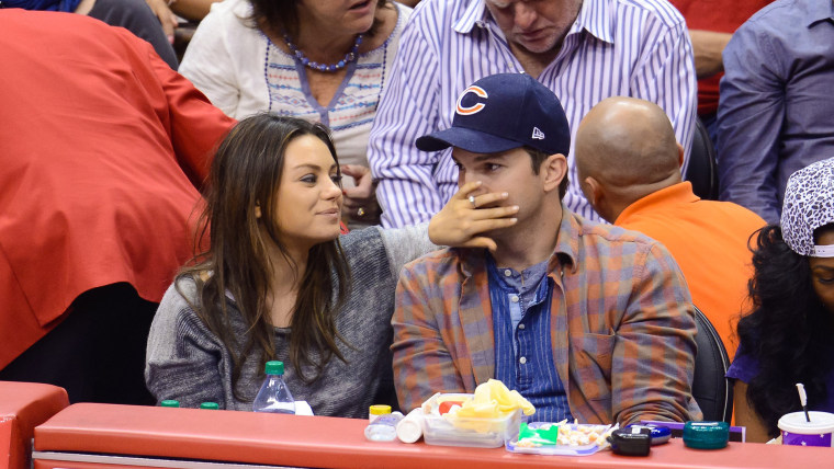 Ashton Kutcher and Mila Kunis at Los Angeles Clippers game