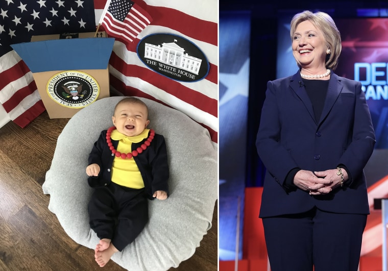Baby Liberty dressed as Hillary Clinton, former first lady, senator, secretary of state, and Democratic presidential nominee.