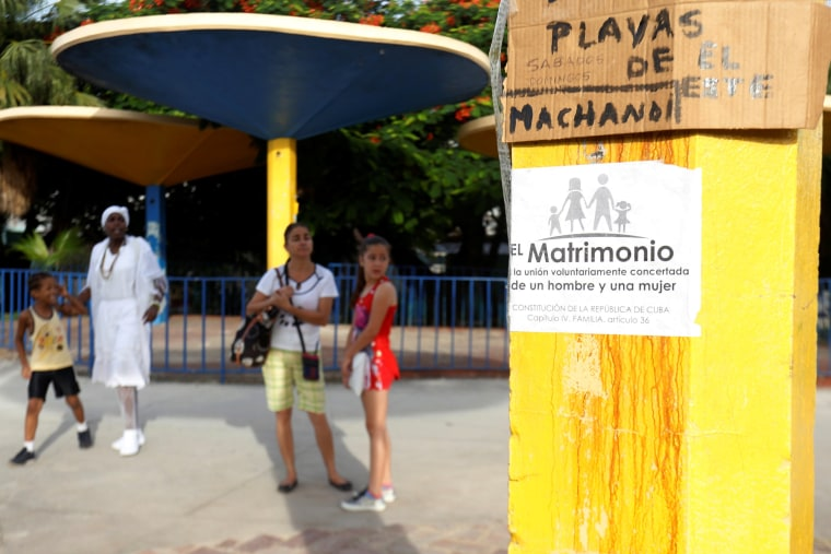 Image: A placard opposing gay marriage is seen on a pole in Havana