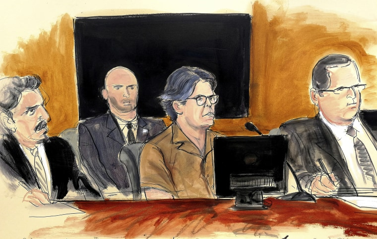 Image: Keith Raniere, second from right, leader of the secretive group NXIVM, attends a court hearing on April 13, 2018, in the Brooklyn borough of New York.