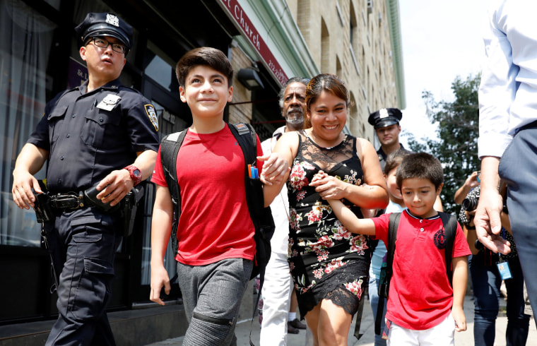 Image: Yeni Gonzalez Garcia, a Guatemalan mother who had been separated from her children, exits the Cayuga Center after being reunited with them in New York
