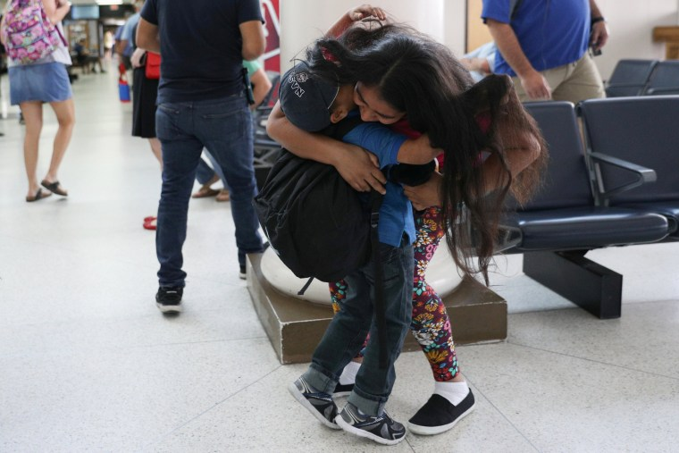 Image: An asylum seeker from Honduras is reunited with her five-year-old son at Brownsville South Padre International Airport in Brownsville