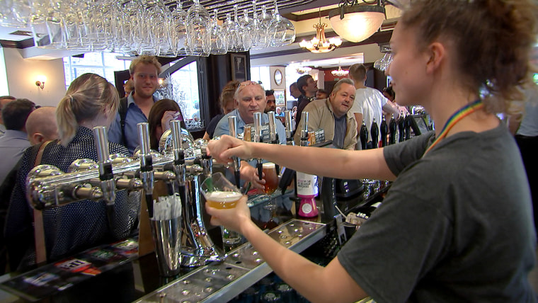 Image: Pulling pints at the Shakespeare's Head, London, one of almost 1,000 J.D.Wetherspoon pubs.