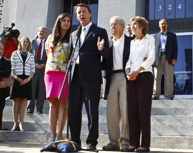 Image: Former U.S. Senator Edwards makes a statement with family members after jury reached verdict at the federal courthouse in Greensboro