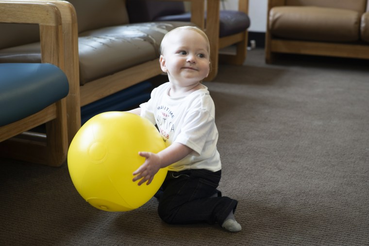Image: Lindsay Landon's son Gabriel plays with a plastic ball inside a playroom in the prison nursery