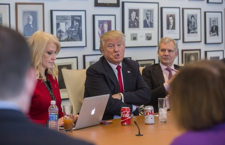 President-elect Donald Trump, with   Kellyanne Conway, left, an aide, during a meeting with Arthur Sulzberger Jr., right, publisher of the New York Times, and reporters, editors and columnists from the paper, at the Times building in New York.