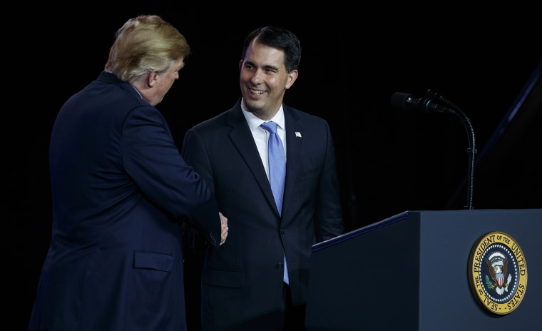 Image: President Donald Trump shakes hands with Gov. Scott Walker, R-Wis.
