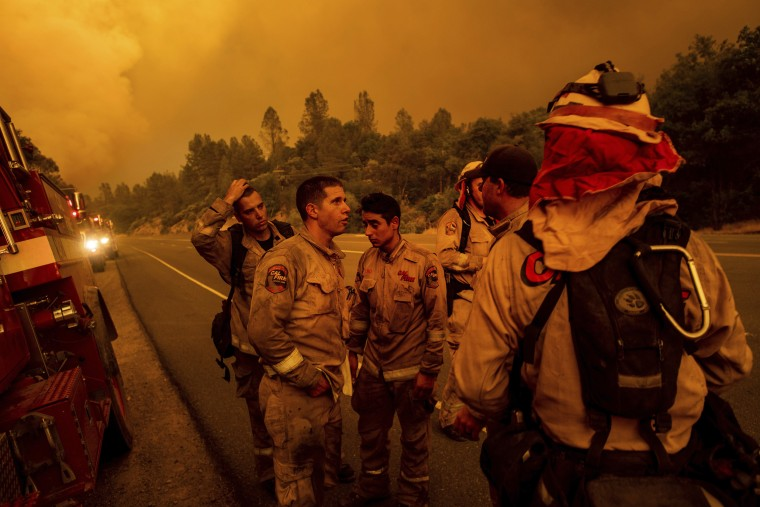 Image: Firefighters discuss plans while battling the Carr Fire in Shasta, California, on July 26, 2018.