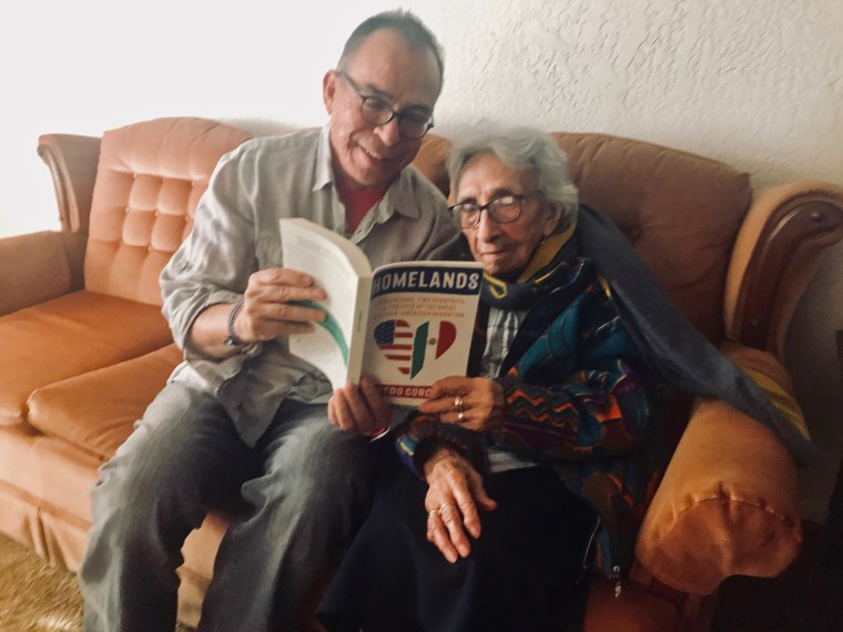 "Alfredo Corchado shares his book ""Homelands"" with his aunt Felicidad Corchado, age 101, the first in his family to emigrate to the U.S."