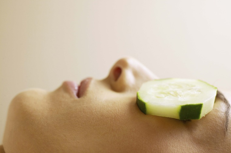Image: Woman with cucumber slices covering eyes